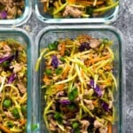 overhead shot of four glass meal prep containers filled with egg roll in a bowl
