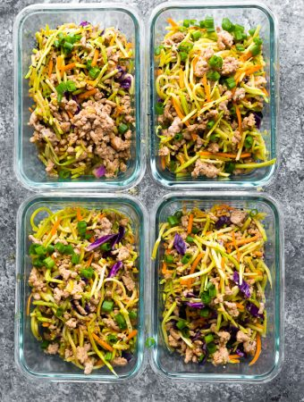 four glass meal prep containers filled with egg roll in a bowl
