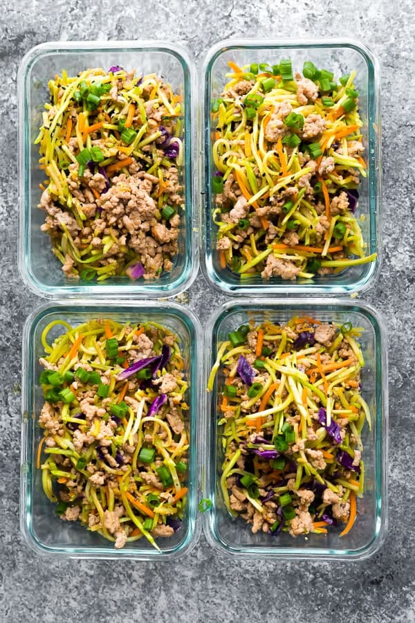 low carb egg roll in a bowl portioned out into meal prep containers