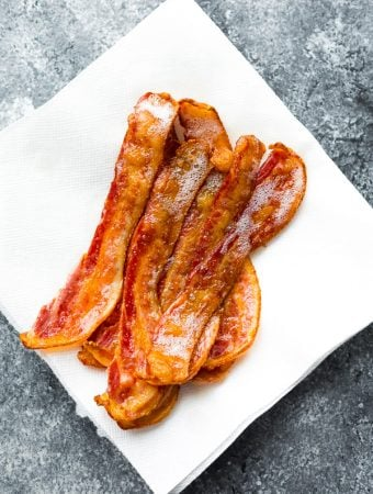 slices of bacon sitting on white paper towel