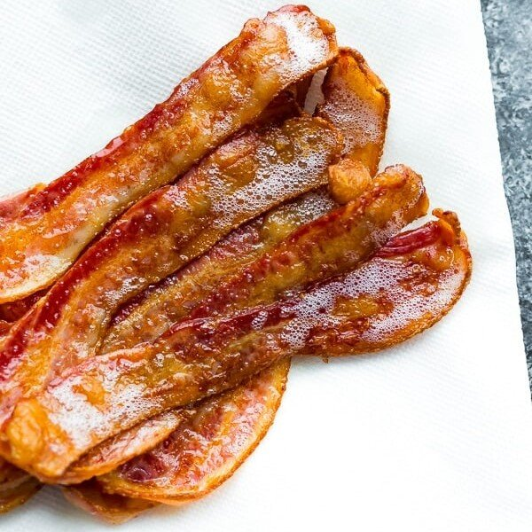 Slices of bacon on a white paper towel
