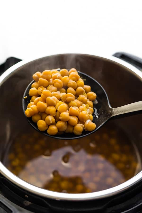 instant pot chickpeas scooped up on a spoon