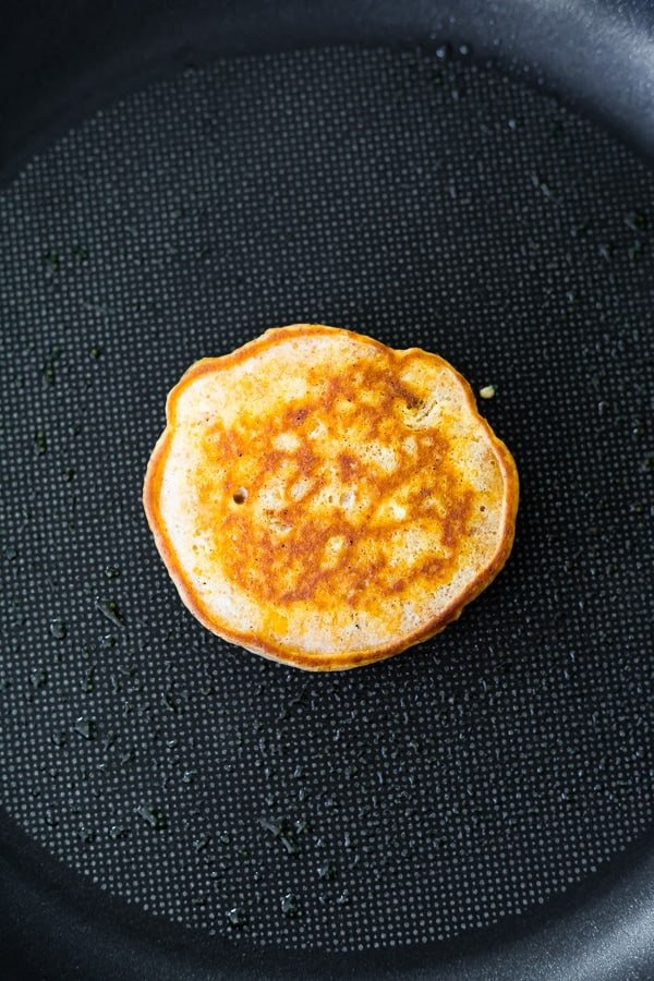 cooking the sweet potato pancakes in nonstick pan