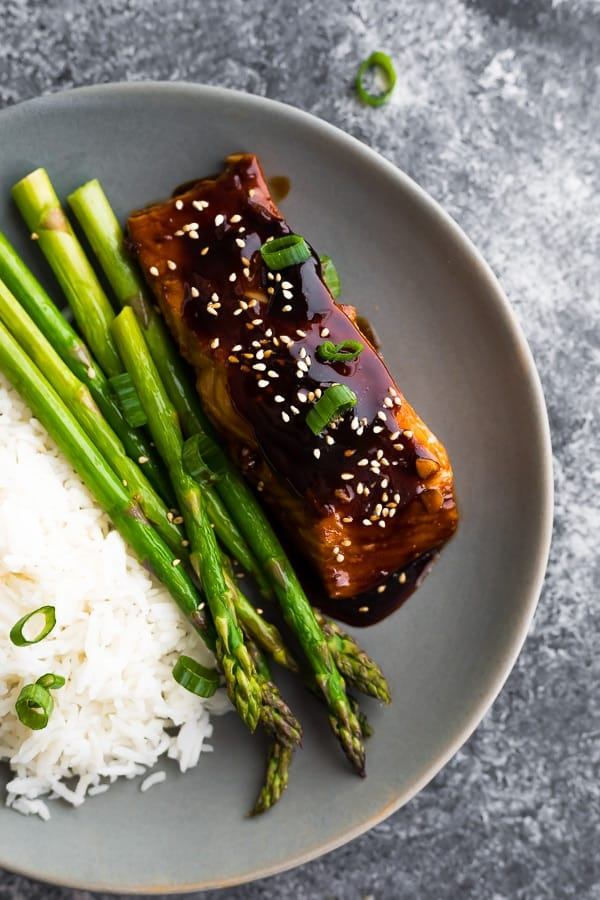 teriyaki salmon glaze on plate with rice and asparagus