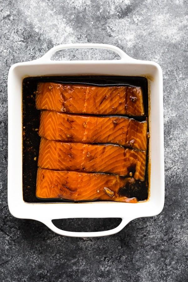 teriyaki salmon recipe in white baking dish before baking
