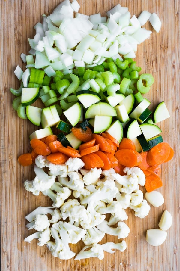 ingredients for the homemade vegetable soup on chopping board