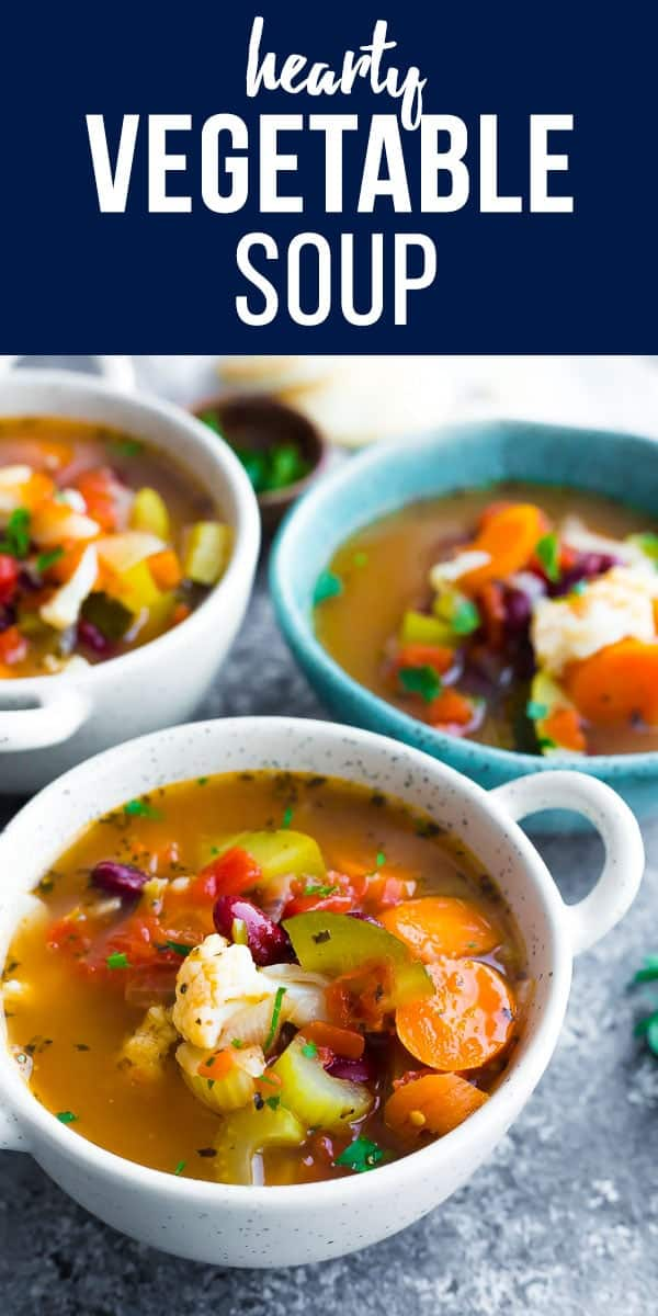This vegetable soup recipe is packed full of healthy veggies and flavor! With carrots, celery, cauliflower, zucchini, tomatoes and kidney beans. vegan vegetable soup, healthy vegetable soup #sweetpeasandsaffron #soup #vegan #glutenfree