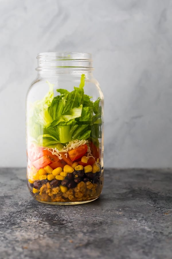 taco salad bowls layered in a mason jar