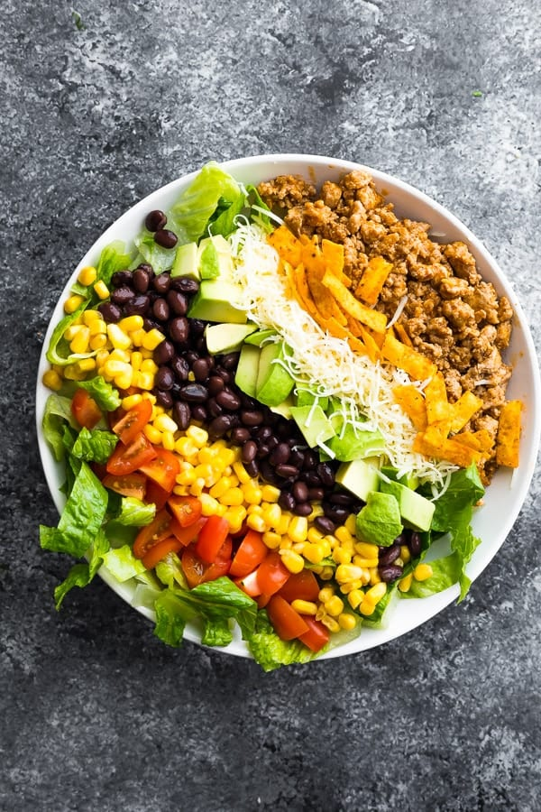 taco salad recipe in bowl before tossing it up