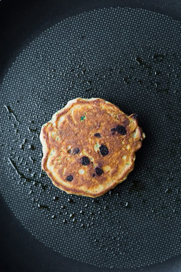 cooking the chocolate chip pancakes in a nonstick skillet