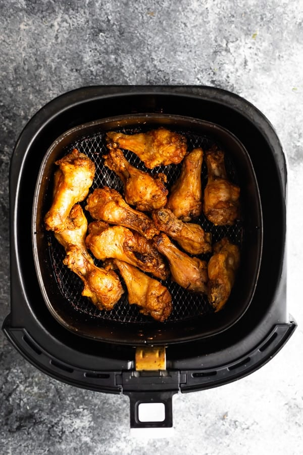 overhead view of air fryer chicken wings cook time in air fryer