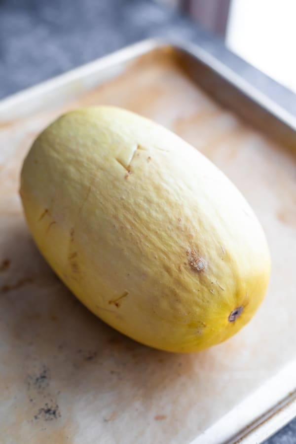 how to cook spaghetti squash in the oven- cooked spaghetti squash on baking sheet