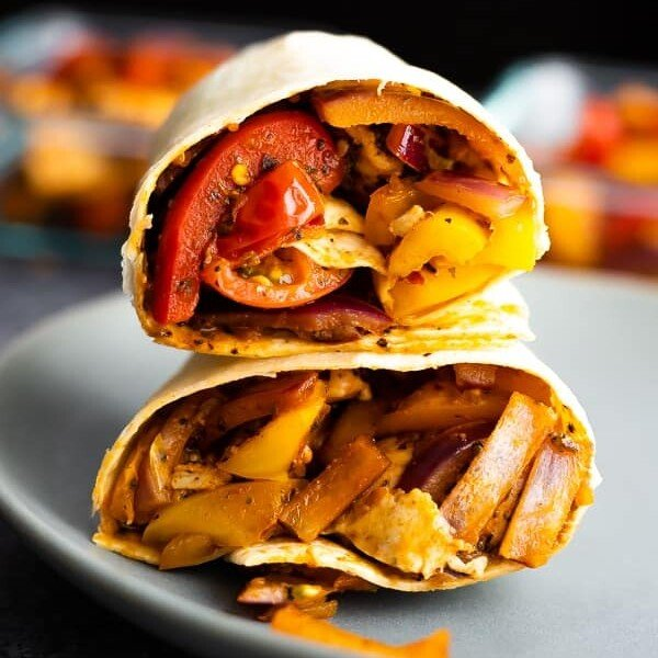 stack of two cajun chicken wraps on blue plate