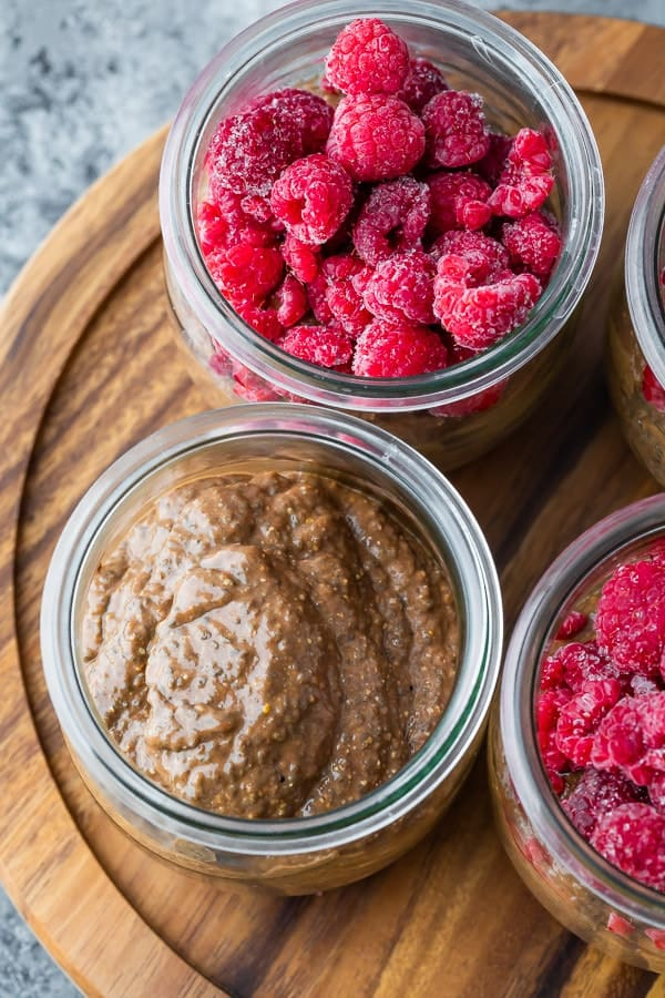 overhead view of chocolate chia pudding in jars