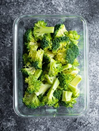 glass meal prep containers filled with cooked broccoli