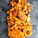 overhead shot of sweet potatoes cut in multiple ways on gray background