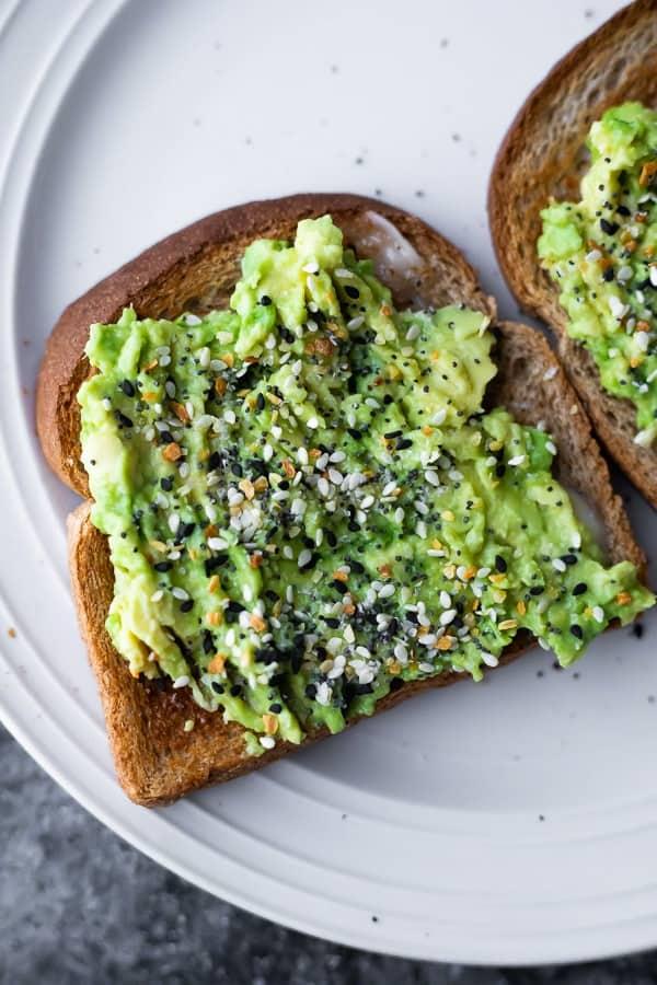 avocado toast shown as how to eat an avocado
