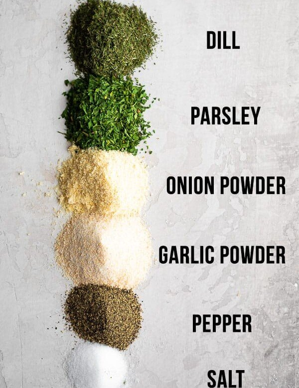ingredients for homemade ranch seasoning on white background and labeled