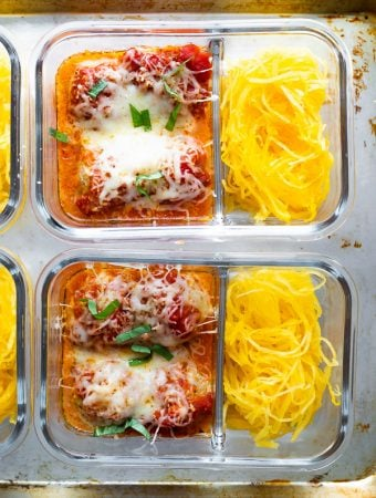 overhead shot of two glass meal prep containers filled with spaghetti squash and meatballs