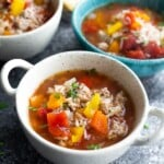 three white and blue bowls of stuffed pepper soup