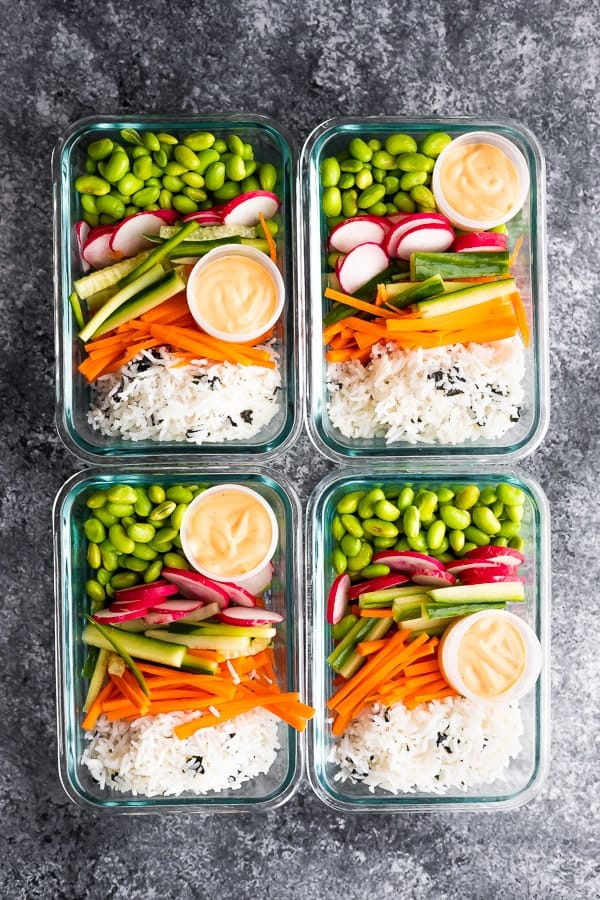 four containers with Vegan Sushi Bowl Meal Prep