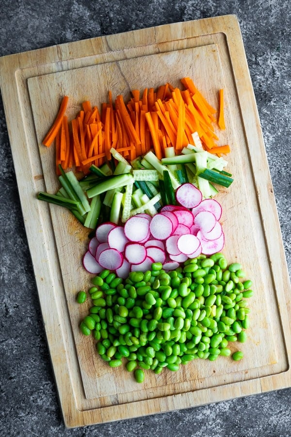 veggies chopped for the Vegan Sushi Bowl Meal Prep on a cutting board