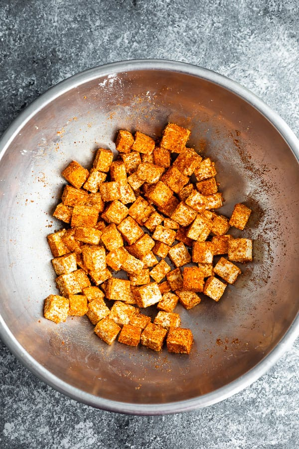 tofu cubes tossed in seasonings for air fryer tofu