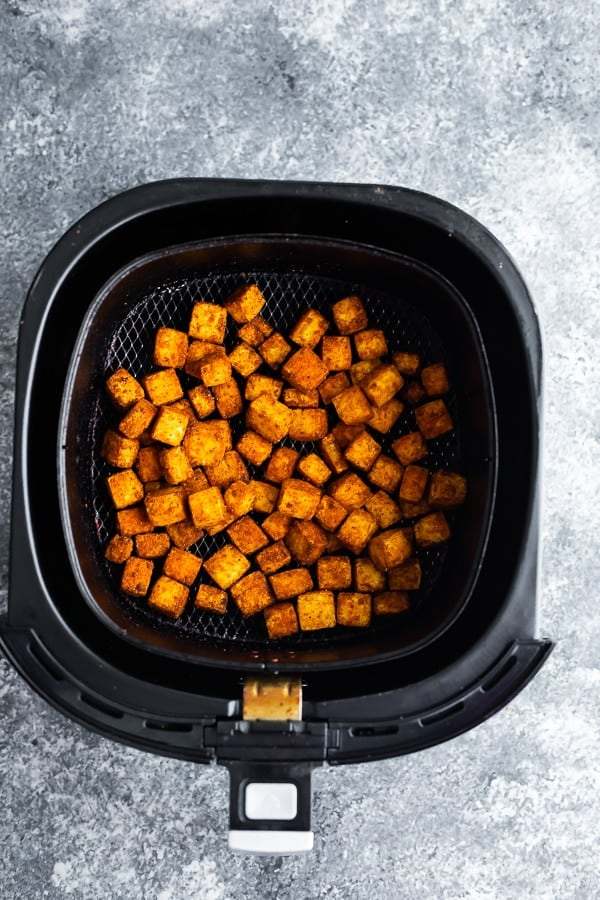 overhead shot of tofu cubes in air fryer