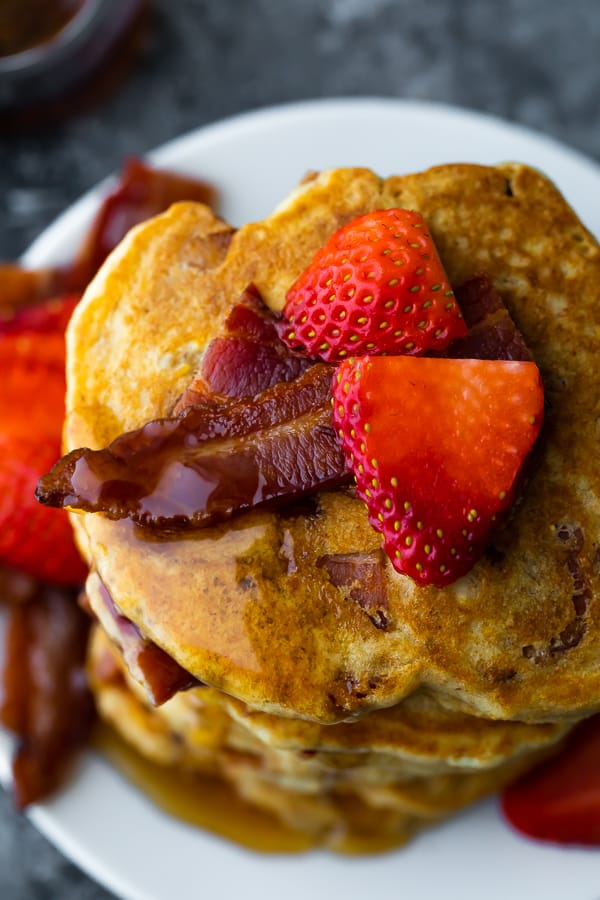 close up shot of a stack of the bacon pancakes recipe