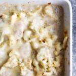 overhead shot of chicken and cauliflower casserole in white baking dish