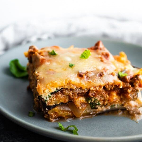 close up of slice of eggplant lasagna on gray plate