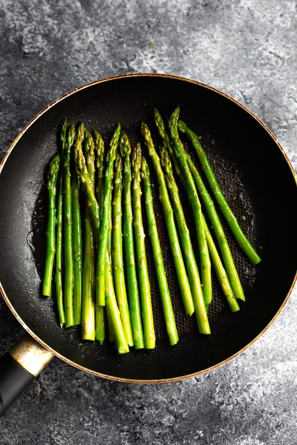 overhead view cooking asparagus in pan