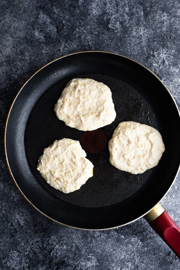 cooking the lemon ricotta pancakes in a non stick skillet