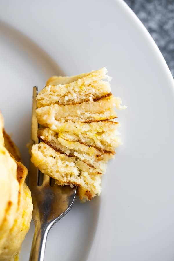a fork with lemon ricotta pancakes recipe on it