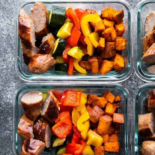 overhead image of glass meal prep containers filled with sheet pan breakfast bake