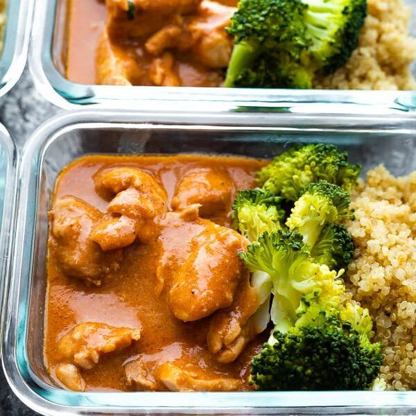 glass meal prep container filled with slow cooker butter chicken and broccoli