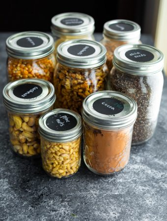 a variety of glass mason jars containing various ingredients