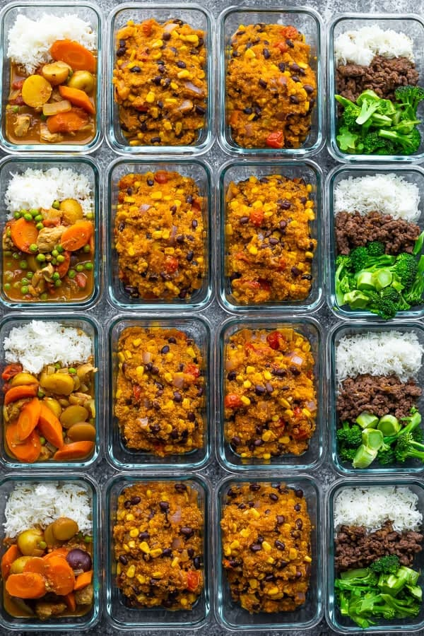 overhead shot of rows of glass meal prep containers with a variety of freezer friendly lunches