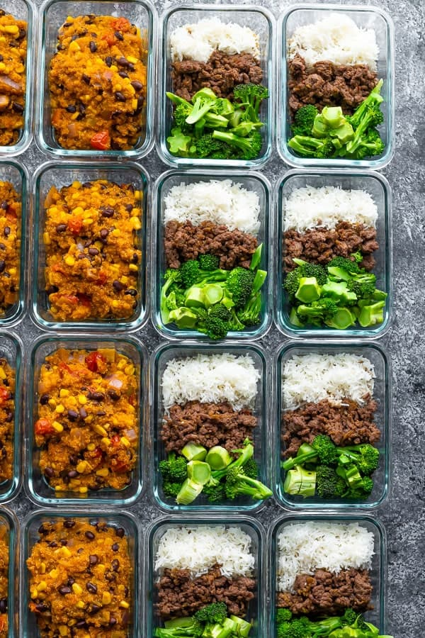 Overhead shot of rows of glass meal prep containers filled with freezer friendly lunch bowls