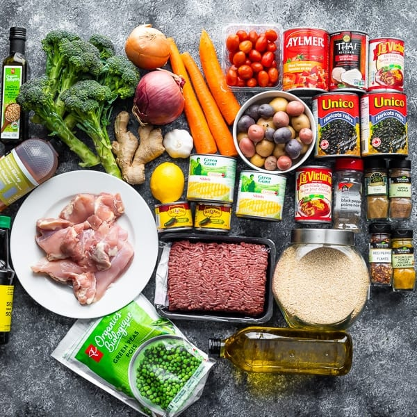 variety of ingredients for freezer friendly lunches on gray countertop