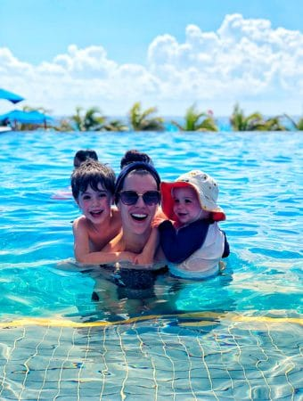Denise in a pool with her two boys