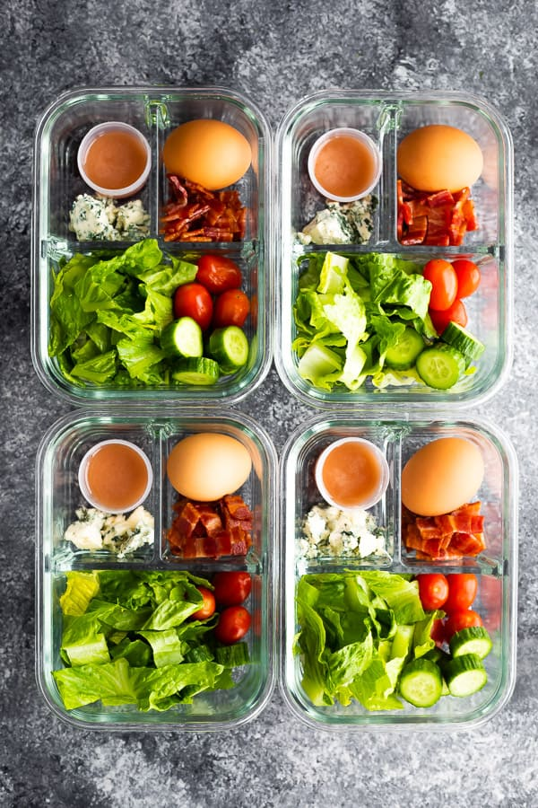 cobb salad recipe portioned out into glass meal prep containers