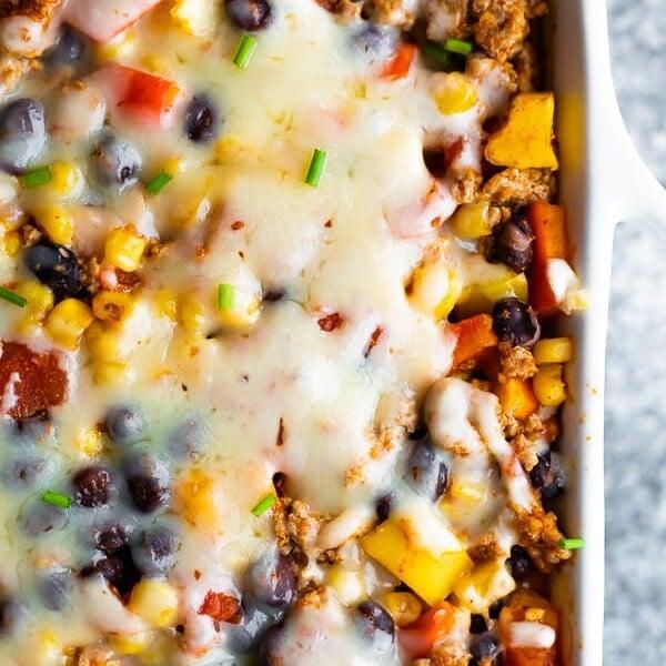 Overhead shot of healthier taco casserole in white casserole dish
