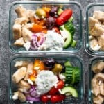 Overhead shot glass meal prep containers filled with Greek chicken meal prep bowls