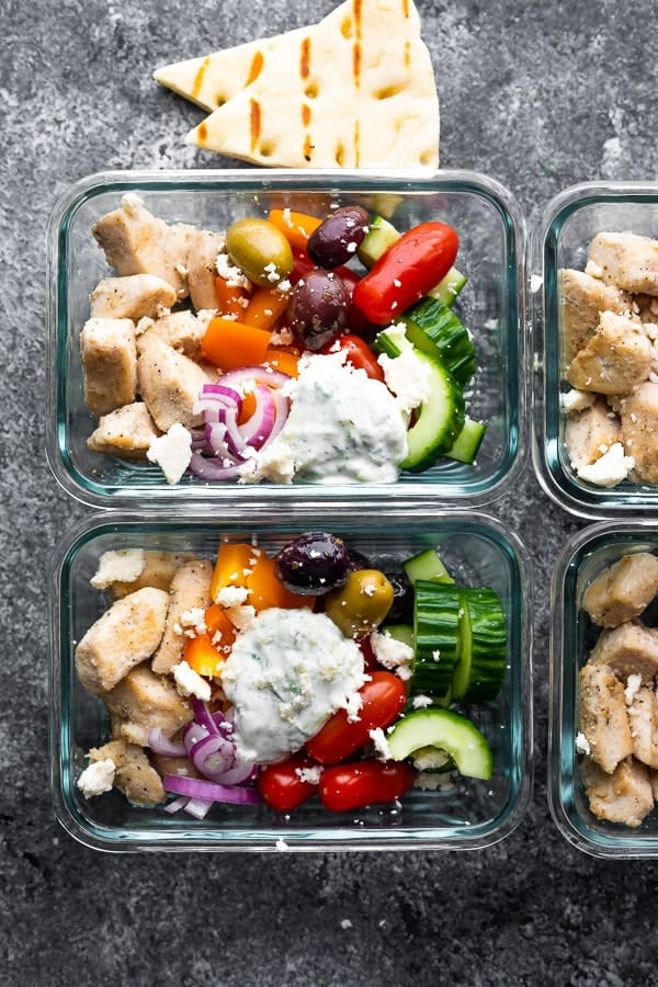 overhead view of Greek Chicken Meal Prep Bowls in meal prep containers