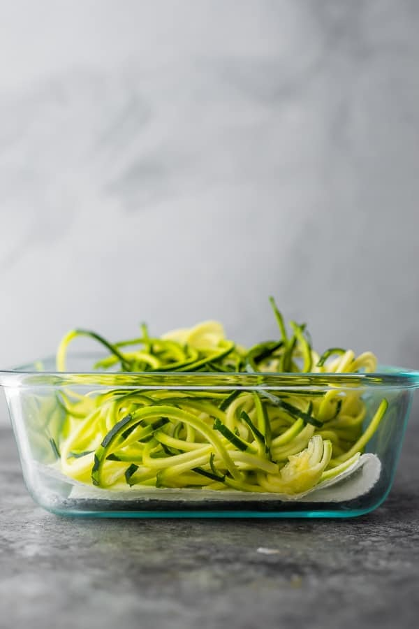 showing how to store before cooking zucchini noodles