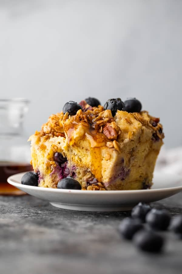 crockpot french toast casserole on plate with syrup dripping down