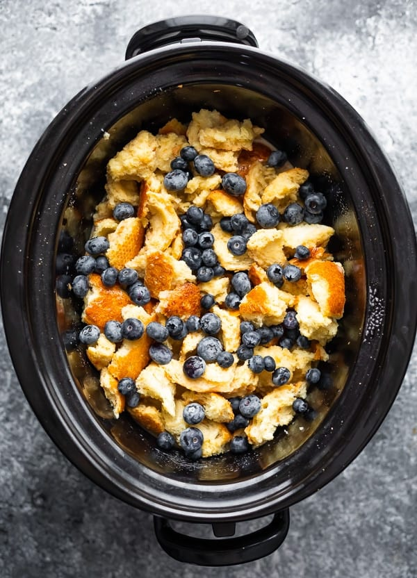 overhead view of french toast casserole crock pot in slow cooker