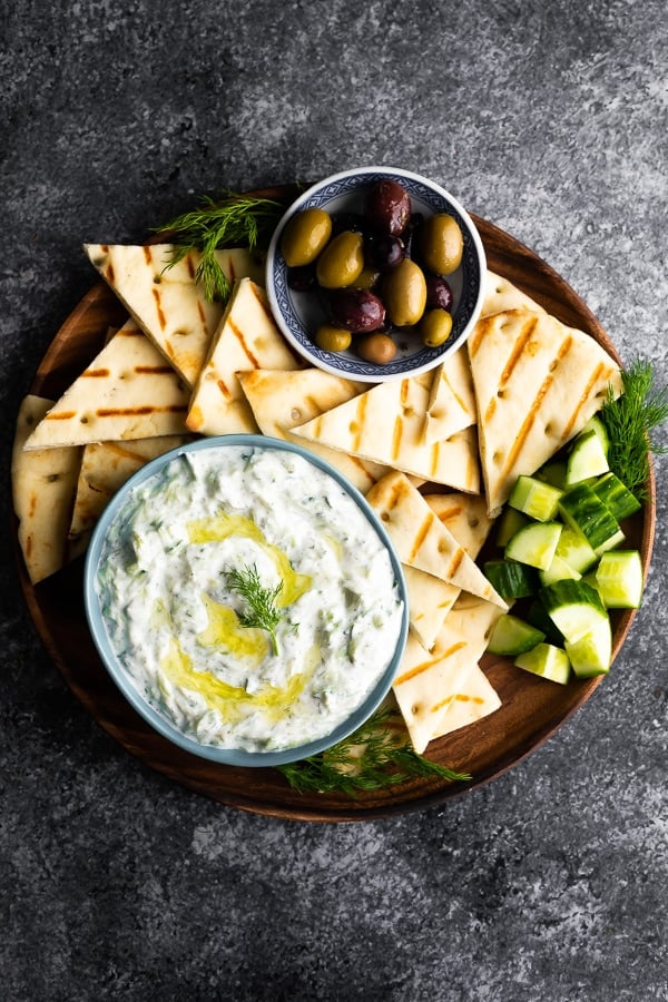 overhead view bowl of tzatziki sauce with grilled pita bread