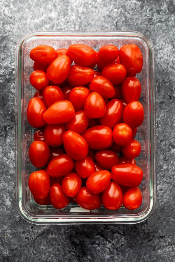 overhead shot of grape tomatoes in glass meal prep container
